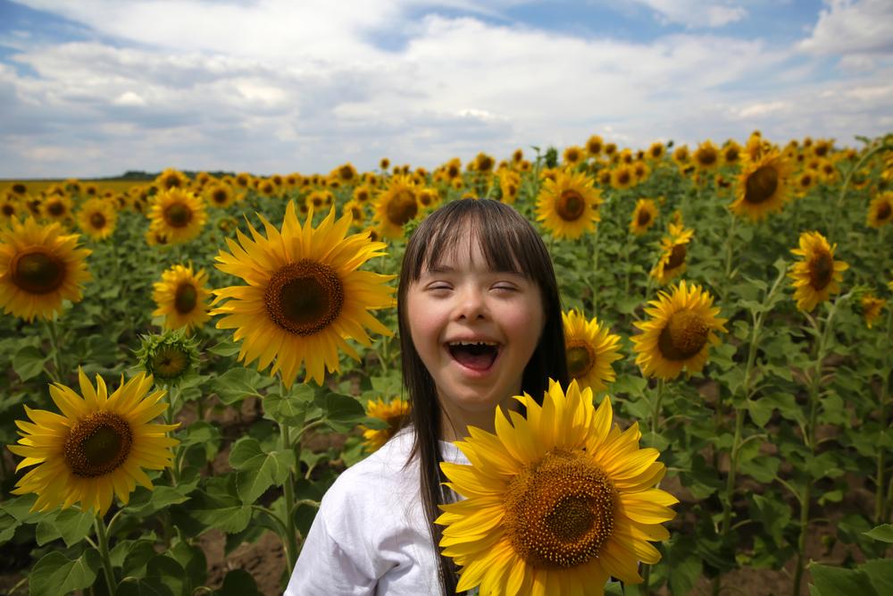 ein Kind mit Down-Syndrome